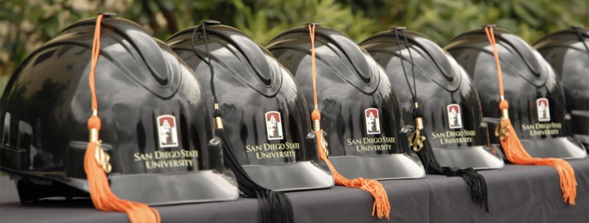 Construction hats with graduation tassels