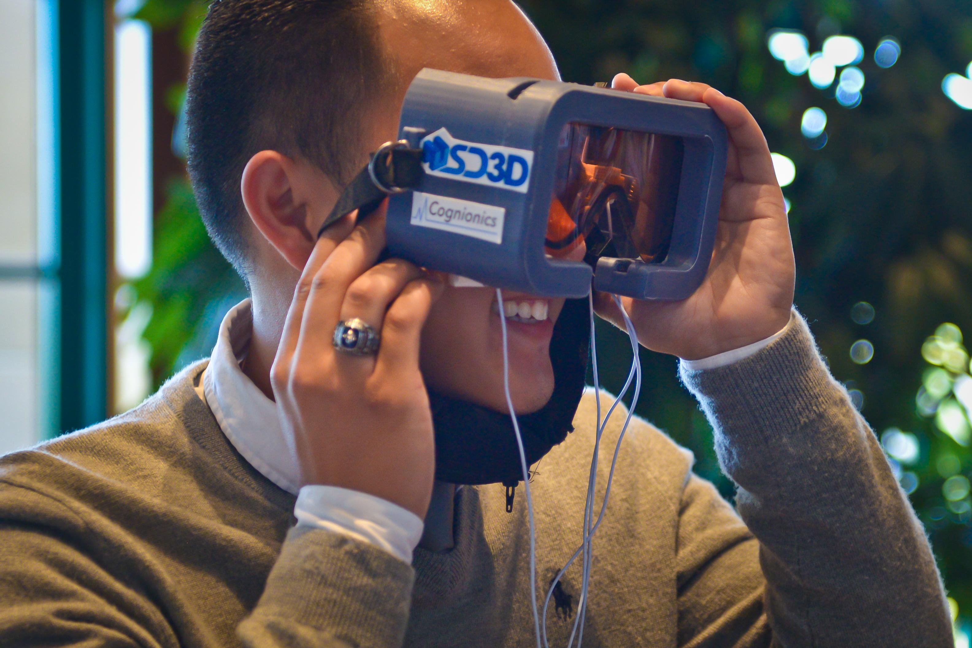 Man looks through a virtual reality project.